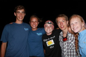 Summer Term students gathered on Boys Dorm Beach for a Fourth of July bonfire.