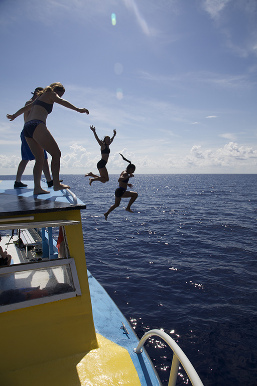 Students jumping of the Cobia during Deep Sea Exploration Field Research.
