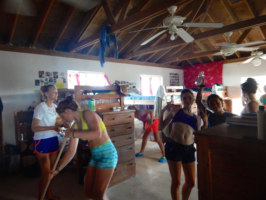Students Jessa, Maddie, Noelle, Lucy and Maya clean their dorm.
