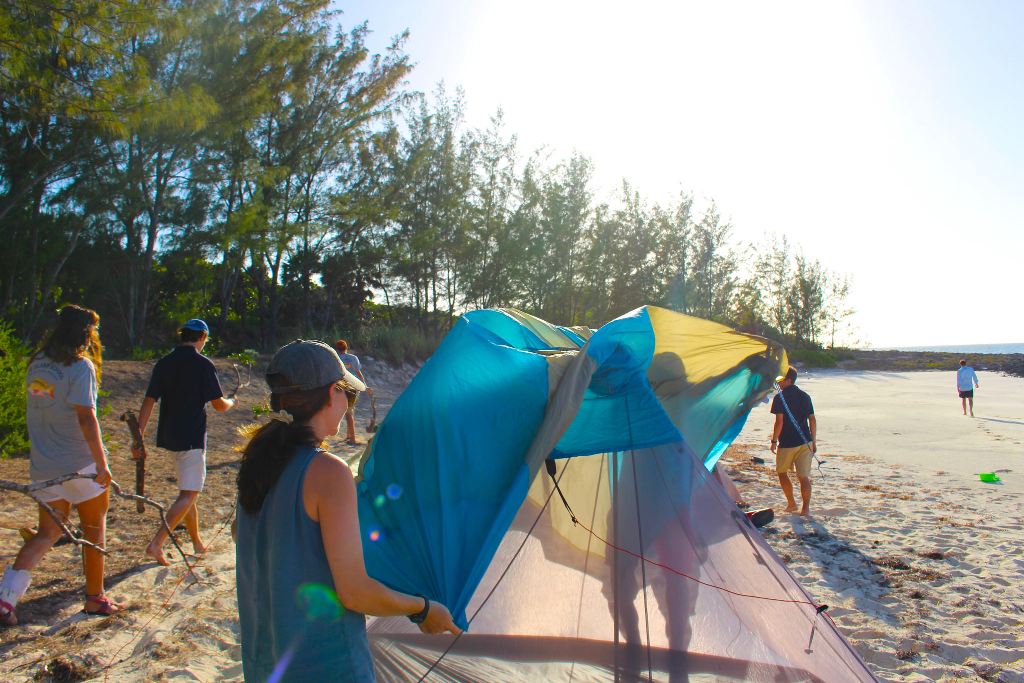 Students and staff work together to set up their campsite during a Down Island trip.